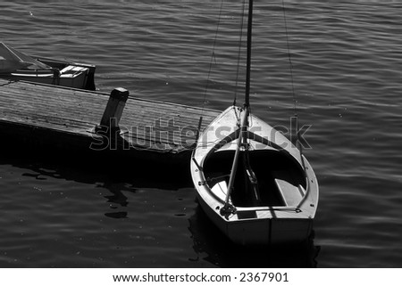 sailboat resting at pier at the charles river in boston massachusetts - stock photo