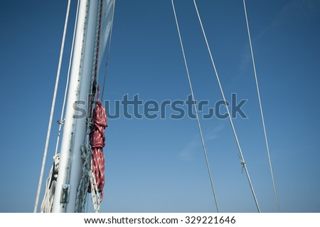 Sailboat rigging against a blue sky
