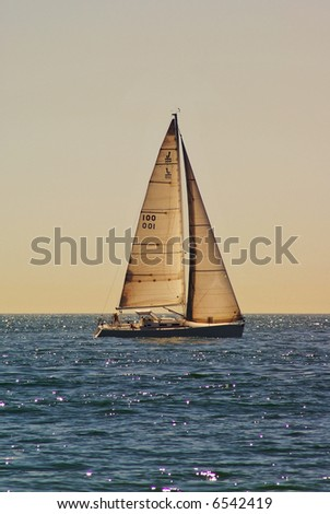 Sailboat Sailing Across Open Waters - stock photo