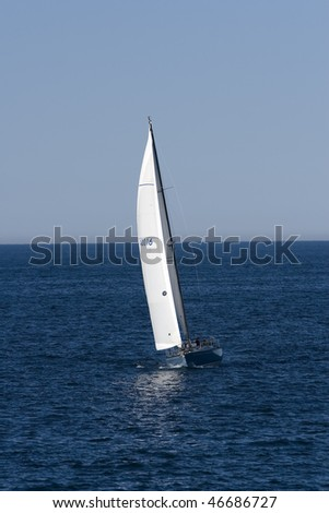 Sailboat sailing blue sea on sunny summer day - stock photo