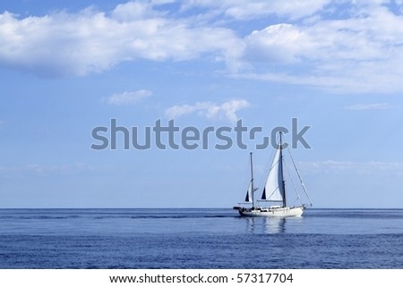 Sailboat sailing on blue sea horizon ocean perfect seascape - stock photo