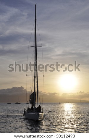 Sailboat silhouette at sunset in Hawaii - stock photo