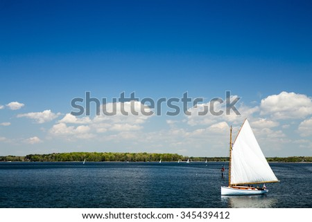 Sailboat viewed from the dock at the Chesapeake Bay Maritime Museum in St. Michael's, Maryland on a beautiful Spring day. - stock photo