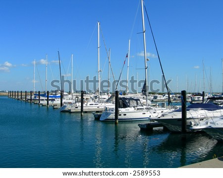 Sailboats aligned in Chicago harbor close to Navy Pier - stock photo
