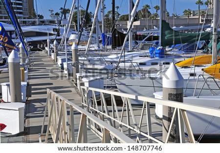 Sailboats and Yachts Docked in Marina - stock photo