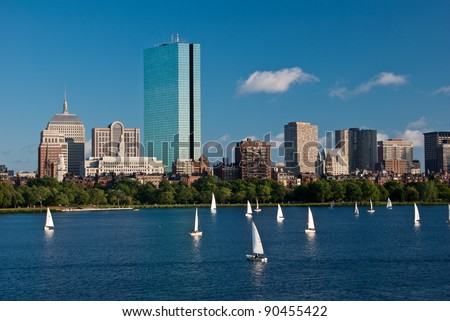 Sailboats are in the foreground of a view of Copley Square as seen from across the Charles River - stock photo