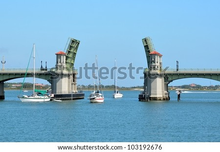 Sailboats going through The Bridge of Lions at historic St. Augustine, Florida, USA. - stock photo