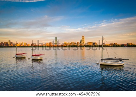Sailboats in the Charles River at sunset, in Cambridge, Massachusetts. - stock photo