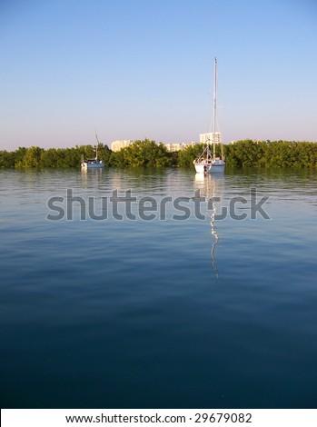 Sailboats on a bay - stock photo