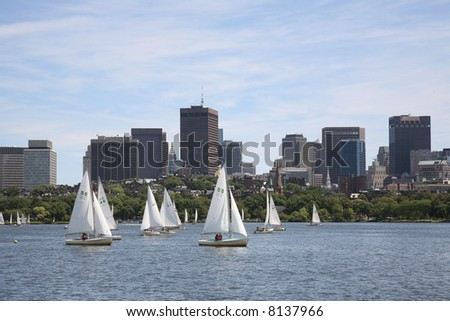 Sailboats on the Charles River with the Boston skyline in the background - stock photo
