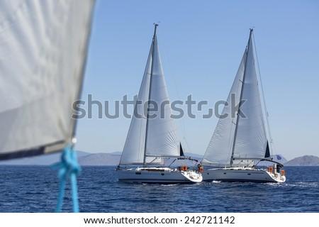 Sailboats participate in sailing regatta. Luxury yachts. - stock photo