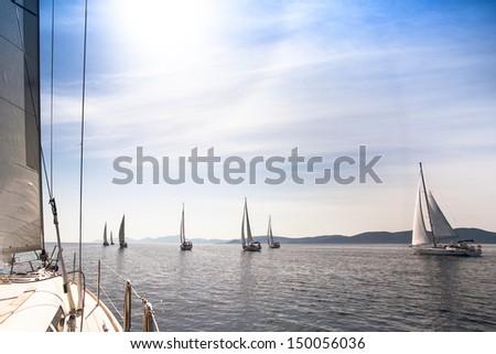 Sailboats sailing sail blue Mediterranean sea - stock photo