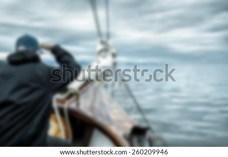 Sailing at sea, captain watching the horizon. Concepts: responsibility, leadership, looking forward. Nautical or maritime background. Intentionally blurred. - stock photo