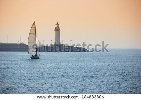 Sailing at sunset. - stock photo