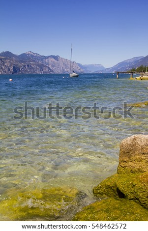 Sailing boat at the lake. Coast of Garda lake, desencano, Italy.