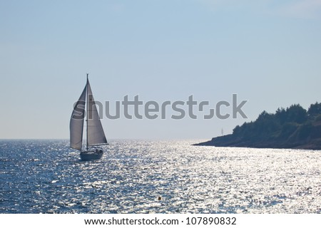 sailing boat in calm beautiful blue sea in croatia - stock photo