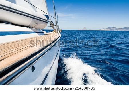 Sailing boat in fast motion view from board - stock photo