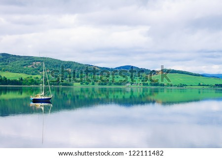 Sailing Boat in Moray Firth near Loch and River ness. Landscape in Inverness Highlands of Scotland, Uk, Europe - stock photo