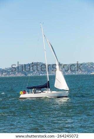 Sailing boat in San Francisco. San Francisco bridge at the background. - stock photo