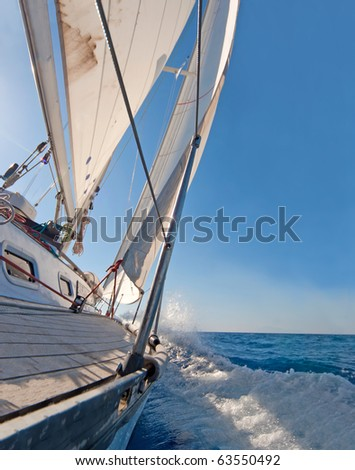 Sailing boat in the sea, blue sky - stock photo