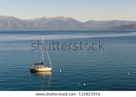 Sailing boat on Lake Tahoe early evening - stock photo