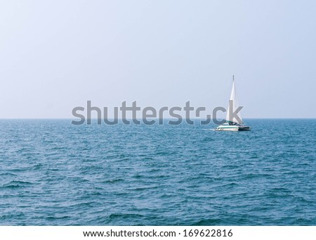 Sailing boat on the clear sea - Small yatch floating