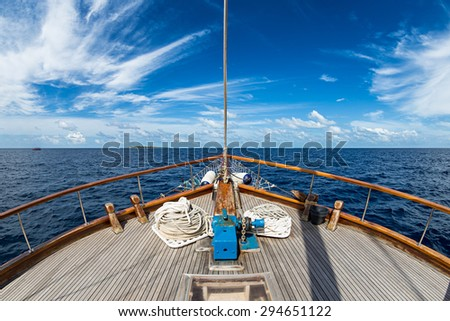 Sailing boat on the wide open ocean - stock photo