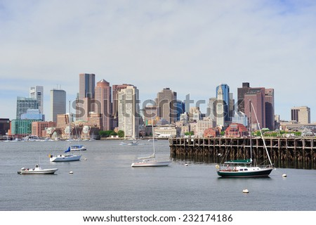 Sailing boat rest with dock in bay and Boston downtown skyline with urban skyscrapers over sea in the morning.  - stock photo
