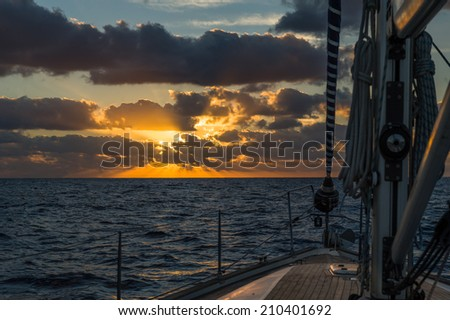 Sailing boat's deck at sunrise. Atlantic ocean. Canary islands. - stock photo