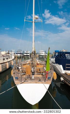 Sailing boat with Italian flag - stock photo