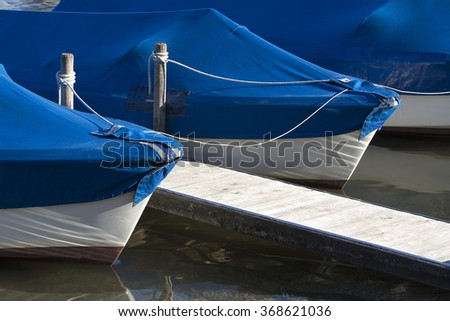 Sailing boats at the pier at the lake Chiemsee in Bavaria
