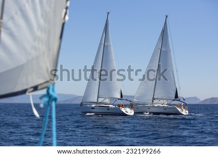 Sailing boats during a sea race. Yacht. Sailing. Yachting. Luxury Lifestyle. - stock photo