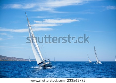 Sailing boats during a sea race. Yacht. Sailing. Yachting. Luxury Yachts. - stock photo