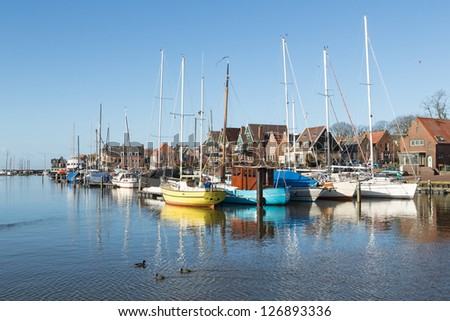 Sailing boats in Dutch harbor of Urk - stock photo
