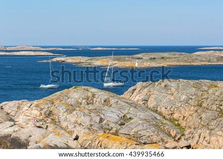 Sailing boats in rocky sea archipelago - stock photo
