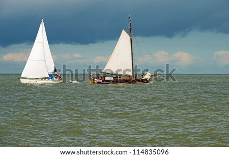 Sailing boats on a lake at fall