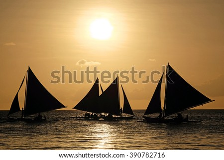 Sailing boats on the sea at the sunset at Boracay island,Philippines - stock photo