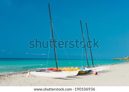 Sailing boats on the shore of Varadero beach in Cuba on a beautiful sunny day - stock photo