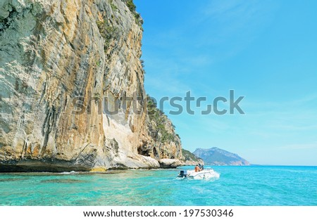 sailing by a huge cliff in Cala Gonone, Sardinia