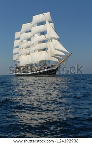 Sailing frigate under full sail in the ocean - stock photo