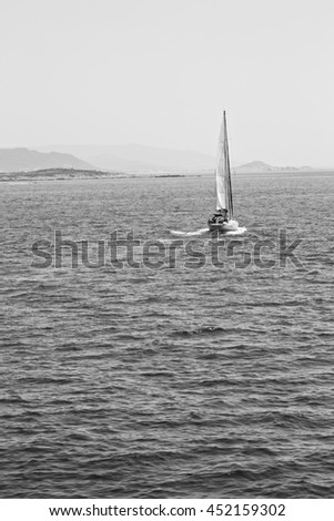 sailing in europe greece santorini island hill  and rocks on the summertime beach