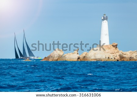 sailing in Sardinia, Monaci island lighthouse, Italy - stock photo