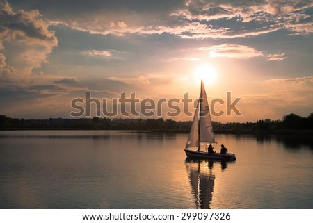 Sailing in sunset - stock photo