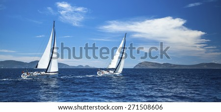 Sailing in the wind through the waves at the Aegean Sea in Greece.  - stock photo