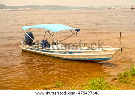 Yellow fishing dory waiting go check stock photo 444324985 for Green boat and motor