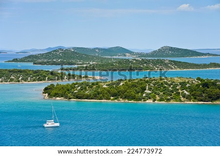 Sailing on sailboat with island in Croatia - stock photo