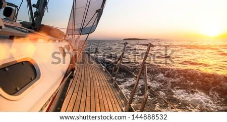 Sailing regatta, during sunset - stock photo