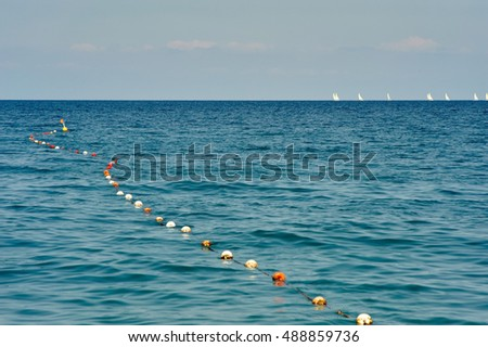 Sailing regatta on blue sea