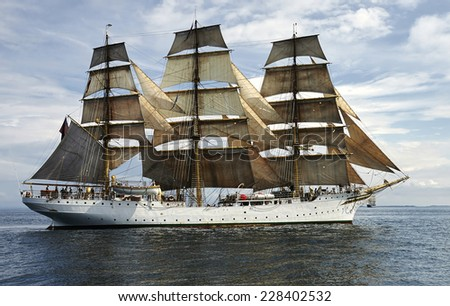 sailing ship against the beautiful backdrop of the sky - stock photo
