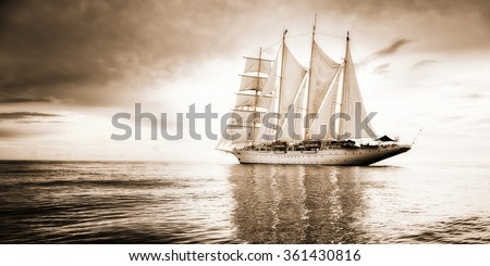 Sailing ship and a beautiful seascape with storm clouds.  Yachting. Sailing.  Toned image and blur. Retro style postcard. - stock photo